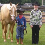 OFFKM boy with horse and 4-H volunteer